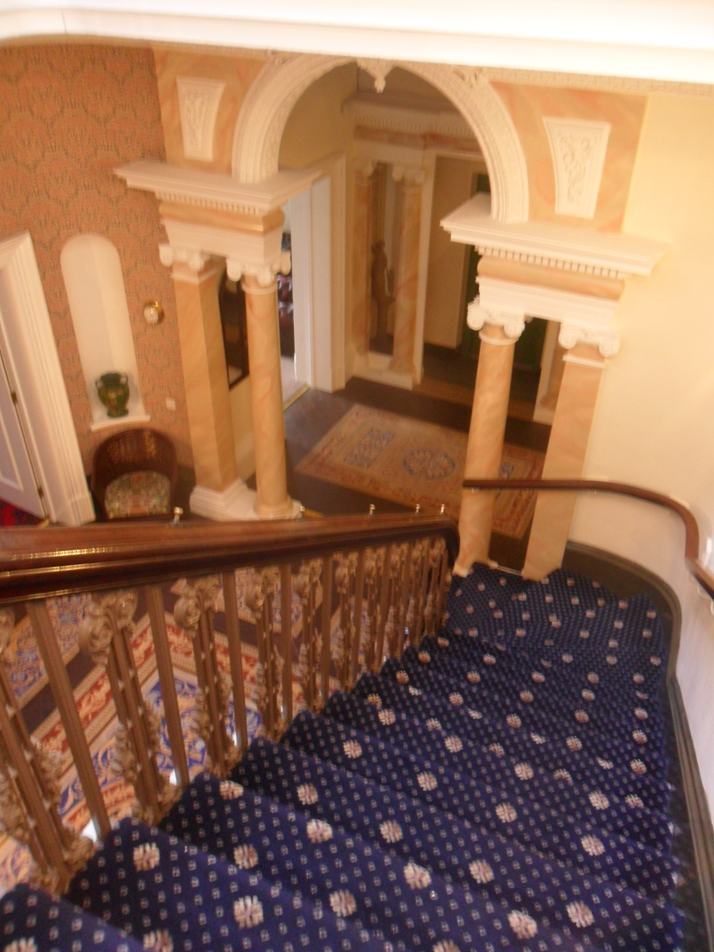 The Mansion House atrium with tiled floor and skylight above
