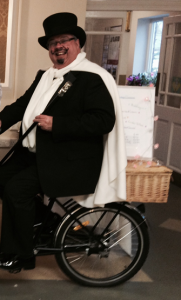 Photograph of our Corporate Director on an Ice Cream Bike at Xmas Fayre